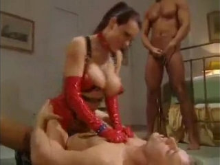 Busty Angelica Sin is so sexy in red latex girdle | bustylatexsexy